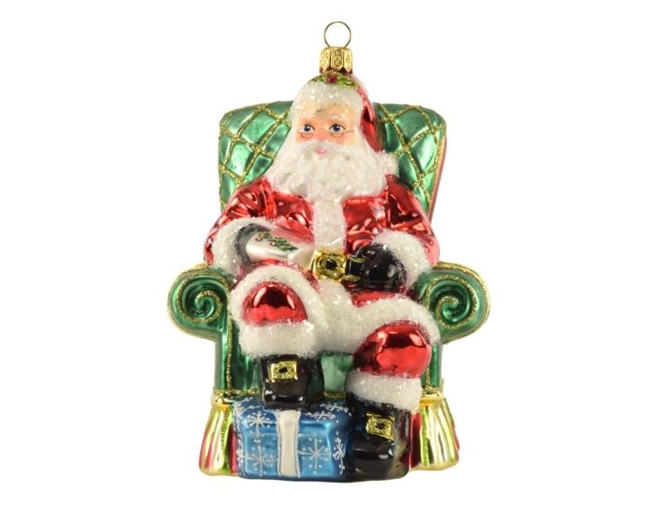 Figurine Père-Noël assis dans son...